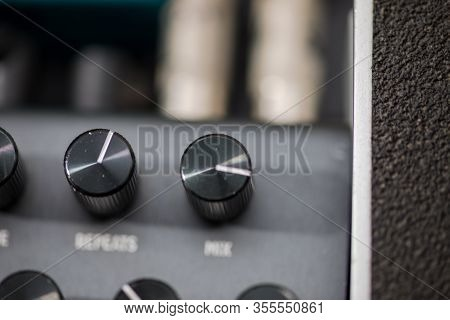 Close-up Details Of Control Knobs On The Top Of A Hardware Effects Pedal Made For Guitars, Synthesiz