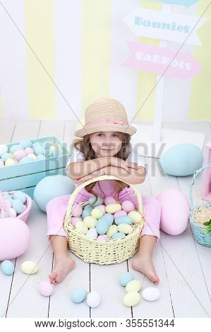 Easter! Girl Holds A Basket With Easter Multicolored Eggs. Easter Colorful Home Decor. Girl Chasing