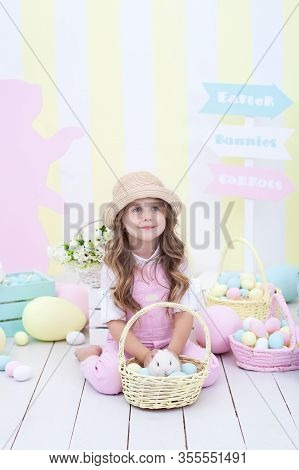 Easter! Little Girl Is Playing With Easter Bunny. Easter Colorful Decor, Basket Of Colorful Eggs. Ba