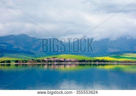 Lake In Mountains. Cloudy Day In Springtime. Beautiful Scenery Of High Tatra Mountains In Dappled Li