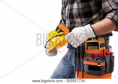 Electrician Holds Wire Stripper Plier In Hand, Helmet With Protective Goggles. Construction Industry