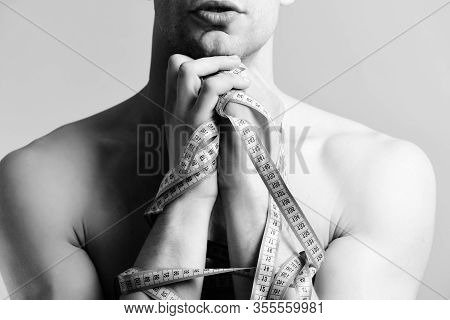 Fitness, Regime And Diet Concept. Man With Tapes For Measuring