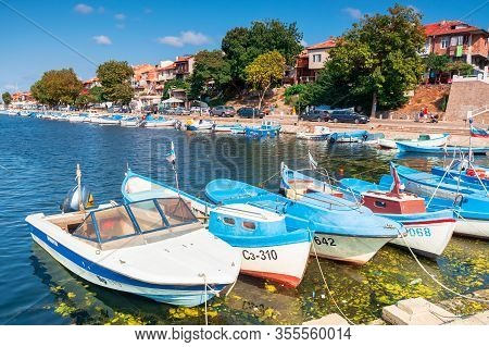 Sozopol, Bulgaria - Sep 09, 2019: Fishing Boats In Port On A Sunny Day. Embankment On The Background