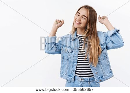 Happy And Pleased Cheerful Blond Girl Celebrating Victory, Smiling Joyfully With Closed Eyes, Deligh