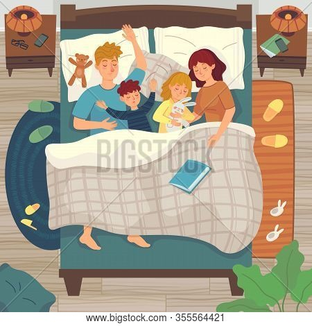 Children Sleep In Parents Bed. Co-sleeping With Child. Dad, Mom And Kids Sleep Together, Asleep Youn