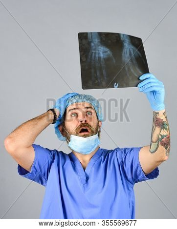 Doctor Examines Radiographic Snapshot. Surgeon Estimate Damages. Hospital Emergency. Doctor Uniform.