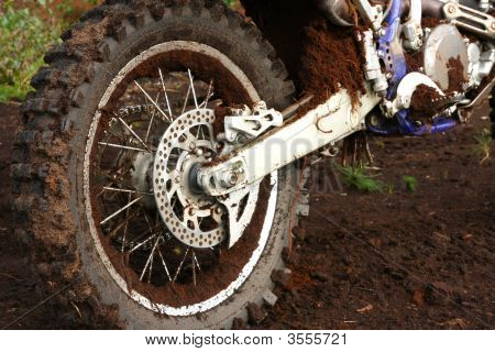 Muddy Rear Wheel Of Dirt Bike