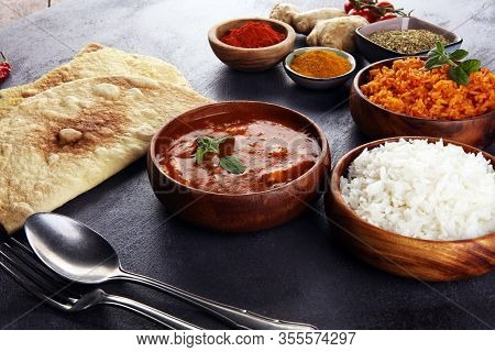 Chicken Tikka Masala Spicy Curry Meat Food In Pot With Rice And Naan Bread. Indian Food With Chicken