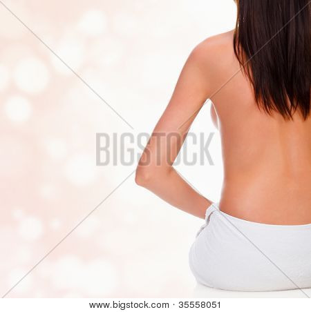 Dishy brunette on blurred background