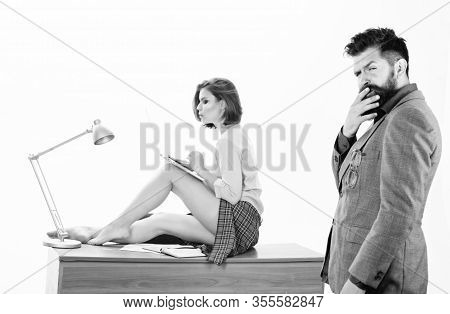 Thinking On Serious Problem. Serious Man Touching Beard By Hand And Sexy Woman Sitting On Desktop. B