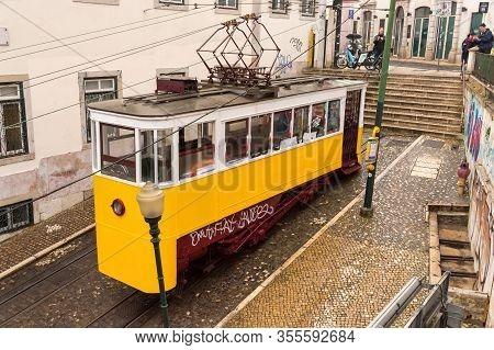Lisbon, Portugal - 3 March 2020: Elevador Da Glória Yellow Funicular In Bairro Alto District