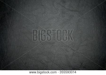 Black Textured Leather Background With Ventiing. Vignette On A Dark Texture Background. Vintage.