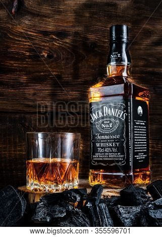 Kyiv, Ukraine - March 11, 2020: Bottle Of Whiskey And A Glass Of Whiskey Jack Daniels. Whiskey On A
