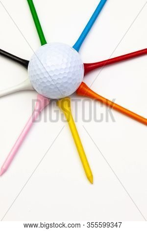 Golf Set - Ball With Tees. Star Composed Of Golf Ball And Wooden Tees. Flat Lay Image.