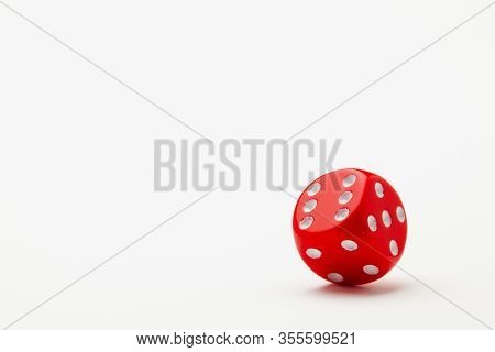 Red Dice On The White Table. Playing Dice At White Wooden Background. Playing A Game With Dice. Risk