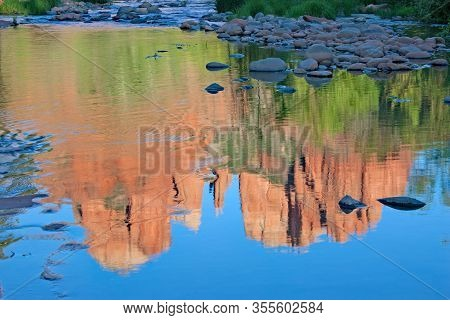 Brilliant Reflections Of Cathedral Rock On Oak Creek Near Sedona, Arizona On Cloudless Summer Aftern