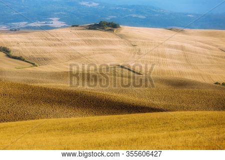 Tuscany Landscape, Fields, Hills. Panoramic View Of Golden Fields Of Tuscany At Sunset After Harvest