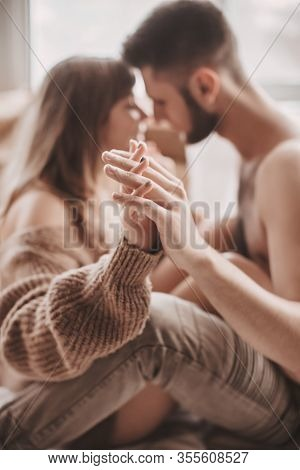 Stock Photo - Portrait Of Happy Loving Couple At Home