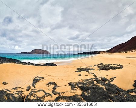 view of beautiful Playa de las Conchas on the Graciosa island near Lanzarote, Canary islands, Spain