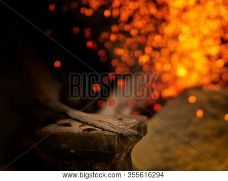 Forge fire in furnace. Blacksmith tempers a steel product in a stove. Smithy forging for hardening and heating iron. Blacksmith stove