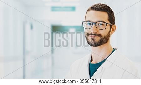 Healthcare, Profession, People And Medicine Concept - Smiling Male Doctor