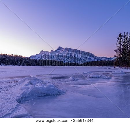 Sunrise In Winter At Two Jack Lake Looking Over At Mt. Rundle In Banff National Park, Alberta, Canad
