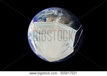 Coronavirus. Covid-19. Coronavirus Pandemic. Coronavirus2019. Earth wears a Paper Face Mask to protect itself from the Coronavirus Pandemic.  Elements of this image furnished by NASA. Wash your hands!