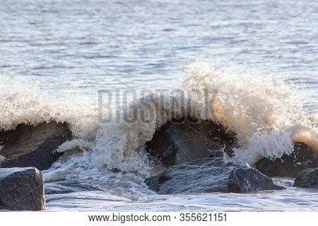 Sea Flood Defence. Waves Crashing On Rocks. Coastal Erosion, Climate Change And Rising Sea Level. Uk
