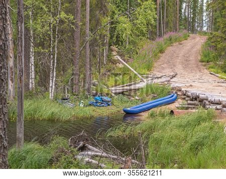 Landscape Of Harsh Karelian Nature With Kayak. Active Extreme Holidays In Karelia. Water Rafting In