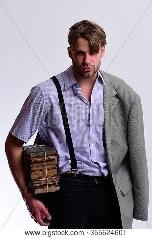 Nerd Or Bookworm Wearing Suspenders And Jacket On Shoulder