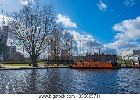 Manchester, United Kingdom - March 1, 2020: Boat Moored In A Canal In New Islington, A Newly Develop