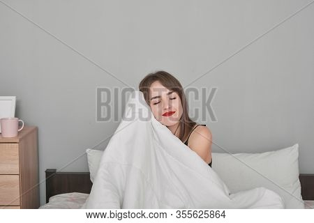 Morning, Relaxation, People Concept - Happy Young Woman In Bed At Home Bedroom Under Blanket. Girl I