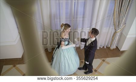 The Guy Invites The Girl To Dance. The Guy Comes To The Girl. Dance Costumes Of The 19th Century. Th