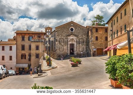 Montalcino, Italy - June 23: Sunny Day In The Picturesque Medieval Streets Of Montalcino, Province O