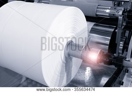 The Operation Of Automatic Plastic Bag Production Machine. Close-up Of The Roller Of The Polyethylen