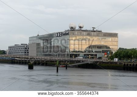 Glasgow, Scotland - July 31, 2019: The Building Of Bbc Scotland Headquarters And The Millennium Brid