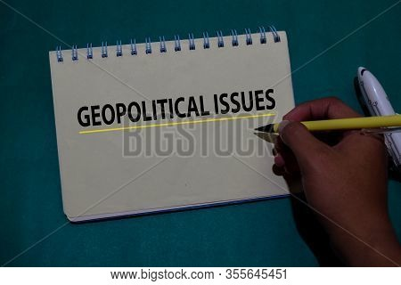 Geopolitical Issues Write On A Book Isolated On Office Desk.