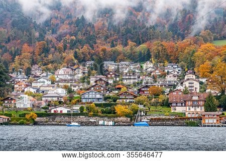 Snow-capped Mountain With Colorful Of Tree In Thun Lake, Interlaken, Switzerland. Early Winter Of No