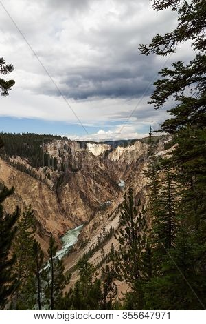 The Wild And Fast Green Water Yellowstone River Flowing Through The Steep Rocky Walls Of The Grand C