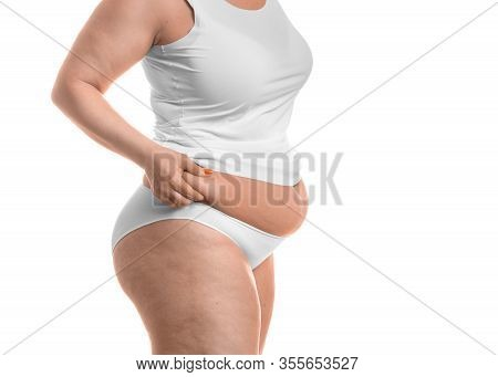Close Up Photo Of A Fat Woman Touching Fat On Her Waist - Isolated Over White Background. Slimming C