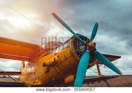 Detail Of Yellow Biplane Cabine, Engine Standing On Airports At Sunset