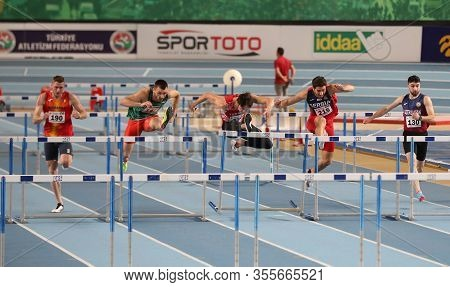 Istanbul, Turkey - February 15, 2020: Athletes Running 60 Metres Hurdles During Balkan Athletics Ind