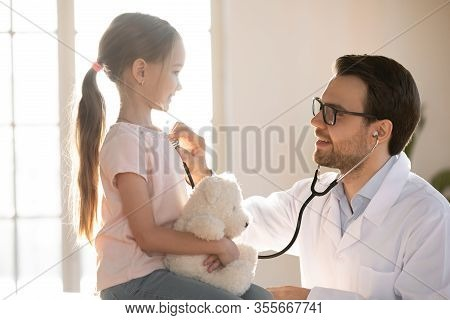 Little Patient Girl Visiting Pediatrician For Checkup.