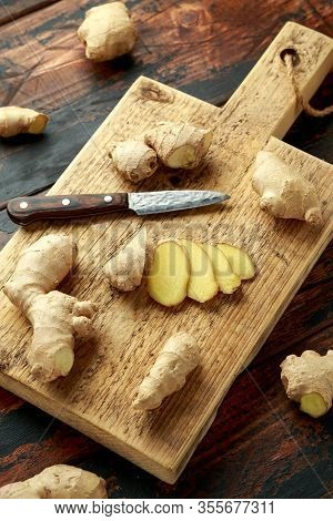 Fresh Slice Of Ginger On Wooden Chopping Board. Healthy Food