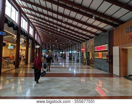 Jakarta, Indonesia - September 17, 2019: People Walking Towards The Boarding Gate At Terminal 2 Soek