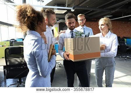 Business Colleagues Say Goodbye To The Dismissed Employee