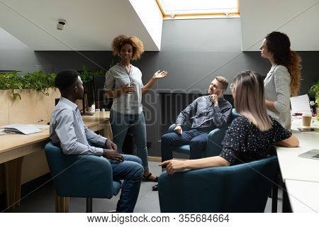 Confident African American Businesswoman Holding Briefing With Colleagues