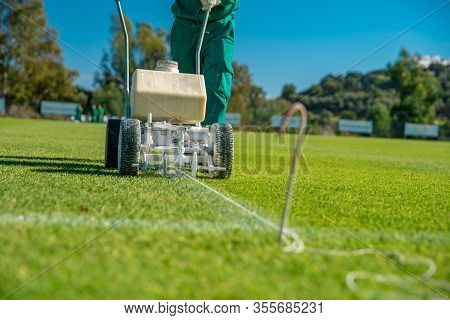 Drawn White Lines On The Football Field With White Paint On The Grass Using A Special Machine Before