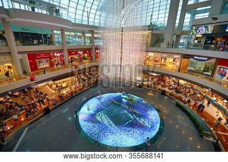 SINGAPORE - JANUARY 20, 2020: view of Digital Light Canvas in Singapore. The Digital Light Canvas display is an interactive digital art installation at the Shoppes at Marina Bay Sands