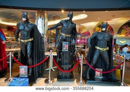 SINGAPORE - JANUARY 20, 2020: Batman life-size statues on display at DC Comics Super Heroes Cafe at the Shoppes at Marina Bay Sands in Singapore.